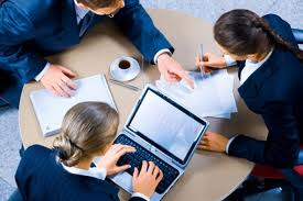 Picture of Technical Support Personnel at a Table